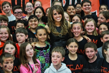 Angie took a moment to pose with the students of the Centerville Elementary School